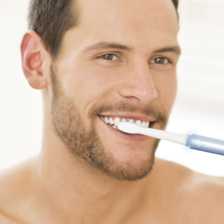 Generic-dentist_SMM_man-brushing-teeth-with-electric-toothbrush